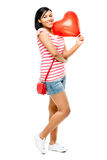 Happy woman red heart shaped balloon romance Royalty Free Stock Images