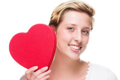 Happy woman with a red heart Stock Image