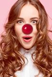 Happy woman on red nose day. stock image