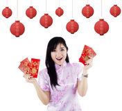 Happy woman with red packet gift Stock Images