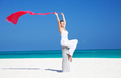 Happy woman with red sarong Stock Images