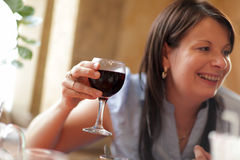 Happy woman with red wine Stock Photo