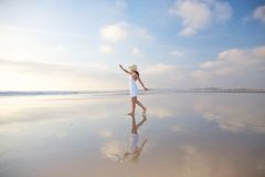 Happy woman reflected on ground royalty free stock image