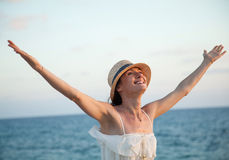 Happy woman  rejoices at summer vacation Stock Images