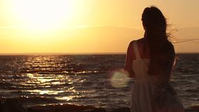Happy woman relaxation on sea beach at sunset stock video footage