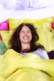 Happy woman relaxes in her bed Stock Photo
