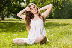 Happy woman relaxing in the aprk Stock Photos