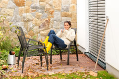Happy woman relaxing autumn patio drinking tea Stock Image