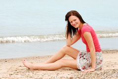 Happy woman relaxing on beach Stock Photos