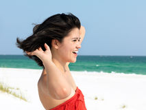 Happy Woman Relaxing on a Beach Royalty Free Stock Photo