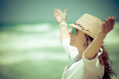 Happy woman relaxing at the beach Stock Image