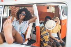 Happy woman relaxing in camper van Stock Image