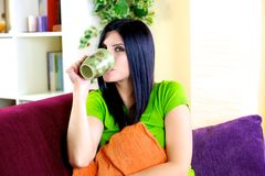 Happy woman relaxing drinking herbal tea at home Royalty Free Stock Photos