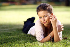 Happy woman relaxing in the grass Royalty Free Stock Photo