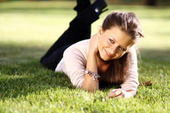 Happy woman relaxing in the grass Royalty Free Stock Images