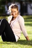 Happy woman relaxing in the grass Stock Image