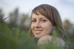 Happy Woman Relaxing On Grass Royalty Free Stock Photo