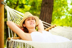 Happy Woman Relaxing in a Hammock Royalty Free Stock Image