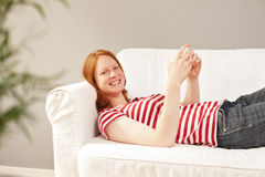 Happy woman relaxing at home Stock Photo