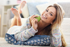 Happy woman relaxing at home Royalty Free Stock Images