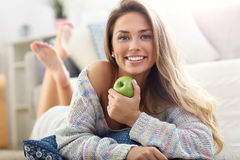 Happy woman relaxing at home Royalty Free Stock Photos