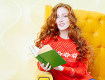 Happy woman relaxing at home and reading a book Royalty Free Stock Photo