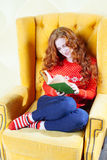 Happy woman relaxing at home and reading a book Stock Photo