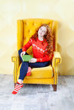 Happy woman relaxing at home and reading a book Royalty Free Stock Images
