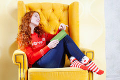 Happy woman relaxing at home and reading a book Royalty Free Stock Photography