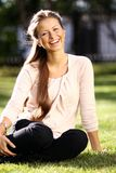 Happy Woman Relaxing In The Grass Stock Photography