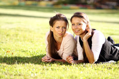 Free Happy Woman Relaxing In The Grass Royalty Free Stock Images - 22097449