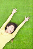 Happy woman relaxing  and lying Stock Images