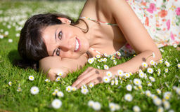 Happy woman relaxing on nature Royalty Free Stock Image