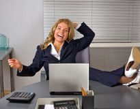 Happy woman relaxing in office Stock Photos