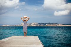 Happy woman relaxing on pier in Sardinia island, Italy royalty free stock images