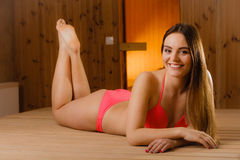 Happy woman relaxing in sauna. Spa wellbeing. Royalty Free Stock Photography