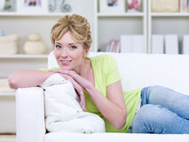 Happy woman relaxing on the sofa Stock Image