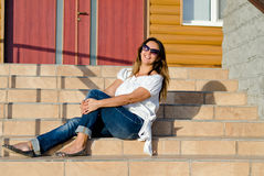 Happy woman relaxing in the sun Royalty Free Stock Photo