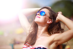 Happy woman relaxing in the sun Royalty Free Stock Image