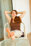 Happy woman relaxing on terrace Stock Images