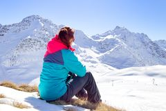 Happy woman relaxing on the top of mountain under blue sky with sunlight at sunny winter day, travel vacation, landscape mountains Stock Photography