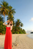 Happy woman relaxing on tropical beach Royalty Free Stock Image