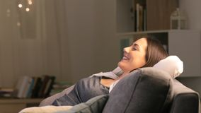 Woman relaxing watching tv in the night stock video