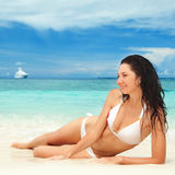 Happy woman rest on the beach Royalty Free Stock Images