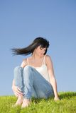 Happy woman rest on the green grass Stock Image