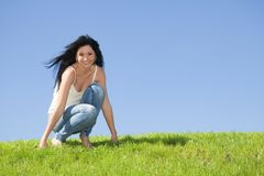Happy woman rest on the green grass Stock Photos