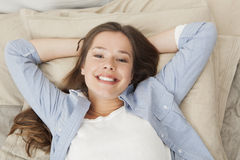 Happy woman resting on the bed Stock Image