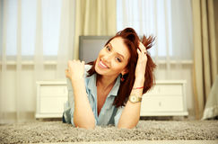 Happy woman resting on the floor Stock Image