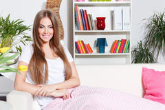 Happy woman resting at home Stock Images