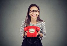 Happy woman with retro style red telephone royalty free stock image